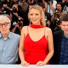 "(FromL) US director Woody Allen, US actress Blake Lively and US actor Jesse Eisenberg pose on May 11, 2016 during a photocall for the film ""Cafe Society"" ahead of the opening of the 69th Cannes Film Festival"