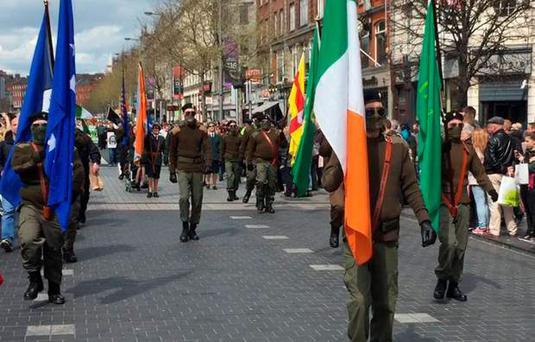 Masked dissident republicans parade through streets of Dublin