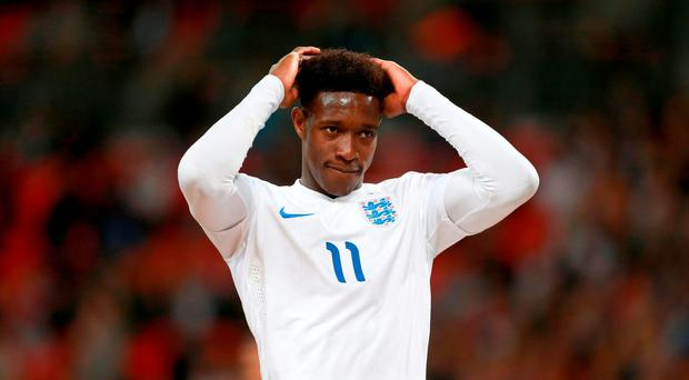 England's Danny Welbeck, who has undergone knee surgery and is expected to be out for nine months, Arsenal have announced on their website.