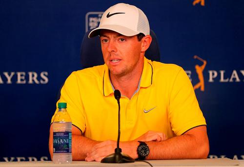 Rory McIlroy of Northern Ireland talks to members of the media during a practice round for THE PLAYERS Championship on The Stadium Course at TPC Sawgrass