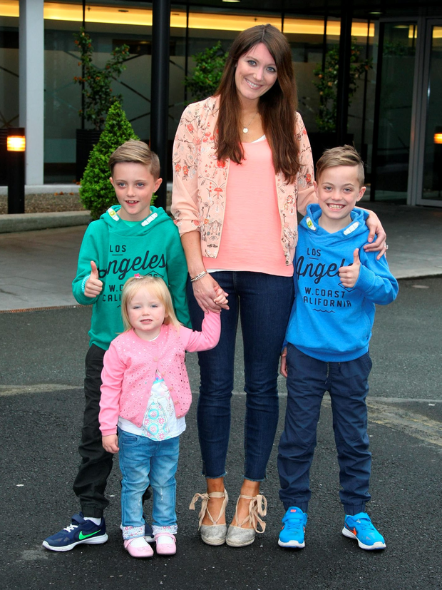 Nicky Byrne's wife Georgina with their twin boys Rocco and Jay (9) and daughter Gia (2) at Dublin Airport yesterday Photo: Mark Doyle