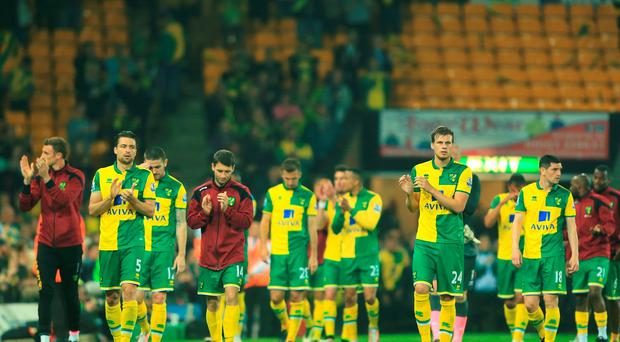 Norwich City players look dejected after they were relegated during the Barclays Premier League match between Norwich City and Watford at Carrow Road