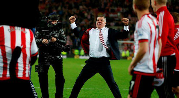Sunderland manager Sam Allardyce celebrates after the final whistle during the Barclays Premier League match at the Stadium of Light, Sunderland