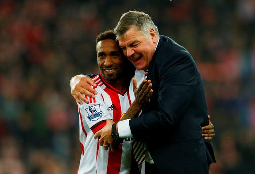 Sunderland's Jermain Defoe celebrates with manager Sam Allardyce after the game Action Images via Reuters / Jason Cairnduff