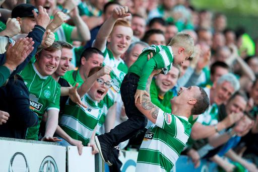 Celtic's Leigh Griffiths celebrates scoring his side's first goal of the game with his son Rhys during the Scottish Premiership match at McDiarmid Park
