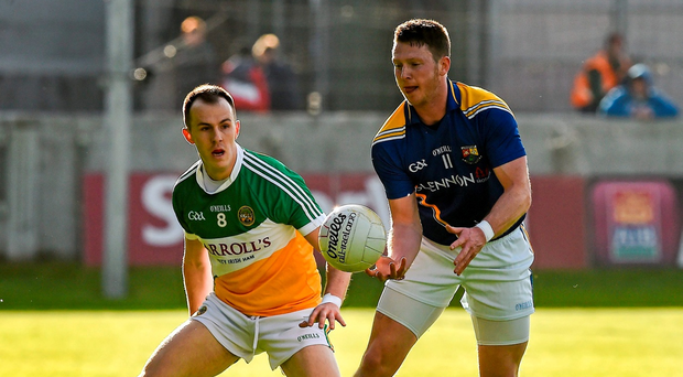 Longford's Paddy Collum battles for possession with Offaly's Alan Mulhall in last year's Leinster Championship. The counties will meet for the fifth time in 18 months on Sunday. Photo: Ray McManus/Sportsfile