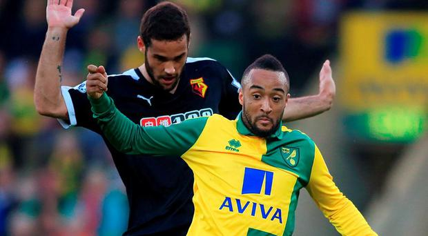 Norwich City's Nathan Redmond in action with Watford's Mario Suarez. Photo: Nick Potts/PA Wire.