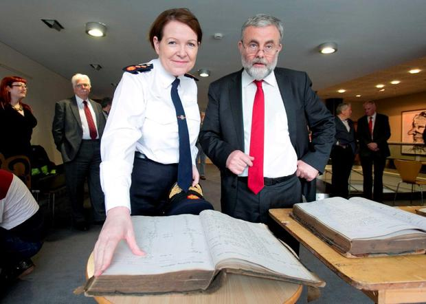 Garda Commissioner Noirin O Sullivan and Siptu chief Jack O'Connor examine the arrest records. Photo: Gareth Chaney / Collins
