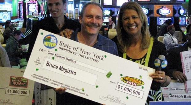 Bruce Magistro with the cheque the first time he won