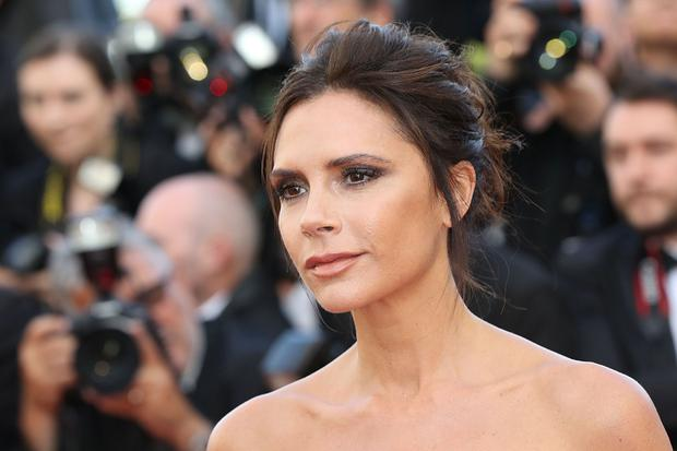 Victoria Beckham poses as she arrives on May 11, 2016 for the opening ceremony of the 69th Cannes Film Festival in Cannes, southern France. / AFP / Valery HACHE