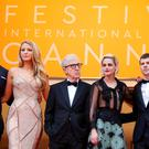 Director Woody Allen (C) and cast members (L-R) Corey Stoll, Blake Lively, Kristen Stewart and Jesse Eisenberg arrive for the opening ceremony and the screening of the film