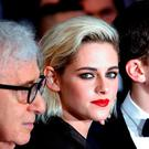 "Director Woody Allen (L), cast members Kristen Stewart (C) and Jesse Eisenberg (R) pose on the red carpet as they arrive for the opening ceremony and the screening of the film ""Cafe Society"" out of competition during the 69th Cannes Film Festival in Cannes, France, May 11, 2016. REUTERS/Yves Herman"