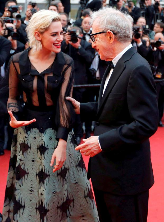 Director Woody Allen jokes with cast member Kristen Stewart on the red carpet as they arrive for the opening ceremony and the screening of the film