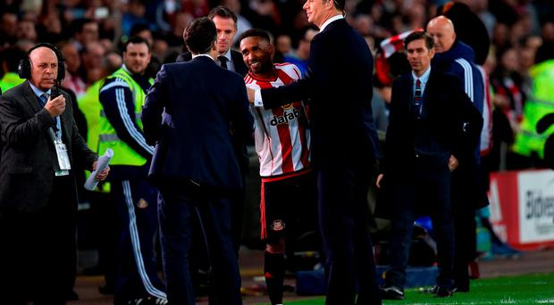 Jermain Defoe of Sunderland shakes the hand of Niall Quinn