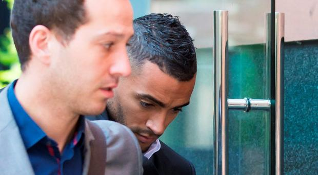 Leicester City footballer Danny Simpson (right) arrives at Manchester Magistrates' Court, Manchester, to pursue with an application to revoke his community order sentence, imposed on June 15 last year after he was found guilty by magistrates of strangling the mother of his child, Stephanie Ward. Jon Super/PA Wire