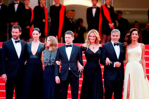 Actors Dominic West, Caitriona Balfe, producer Jodie Foster, actors Jack O'Connell, George Clooney and his wife Amal Clooney attend the