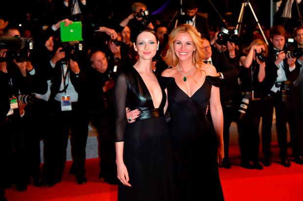 US actress Julia Roberts (R) and Irish actress Caitriona Balfe pose on May 12, 2016 before leaving the Festival Palace after the screening of the film