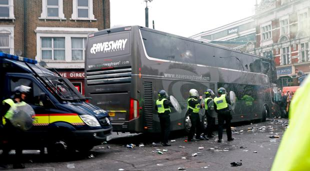 General view as bottles are thrown at the Manchester United team bus before the match