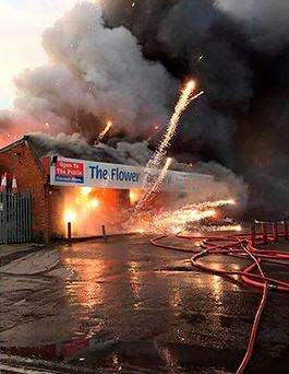 Scene of a major blaze which broke out at a garden centre which sells fireworks in Southampton, causing explosions and fireworks to be set off Credit: Hampshire Fire and Rescue Service/PA Wire