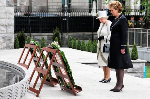 The Queen lays a wreath at the Garden of Remembrance, accompanied by then President Mary McAleese. Photo: Maxwells/PA Wire