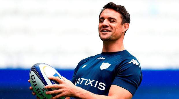 Dan Carter of Racing 92 shares a joke with team-mates during the Captain's Run ahead of the European Rugby Champions Cup Final against Saracens at Grande Stade de Lyon today (Photo by Stu Forster/Getty Images)