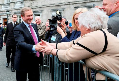 Enda Kenny is congratulated by a supporter after his election as Taoiseach on May 6. Photo: PA Wire