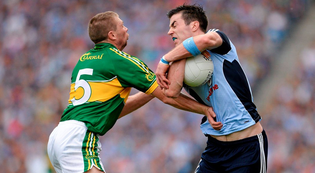 Tomas O Se and Michael Darragh Macauley do battle during Dublin's victory over Kerry in the 2013 All-Ireland semi-final (SPORTSFILE)