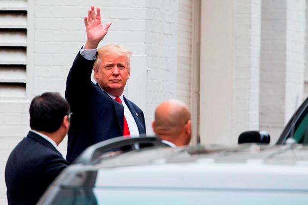 Republican presidential candidate Donald Trump waves as he arrives for a meeting with House Speaker Paul Ryan at the Republican National Committee Headquarters on Capitol Hill in Washington. Photo: AP