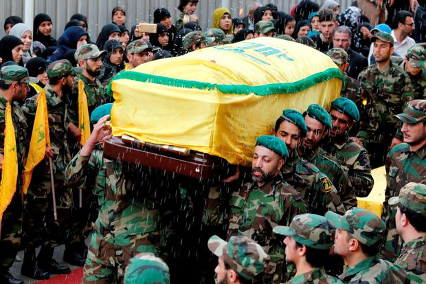 Rice is thrown as Hezbollah members carry the coffin of top Hezbollah commander Mustafa Badreddine. Photo: Reuters
