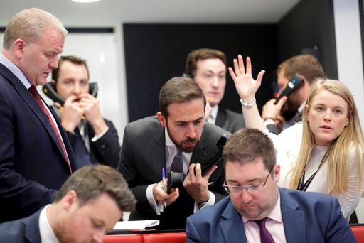 Traders and clerks react on the floor of the London Metal Exchange. Photo: Reuters
