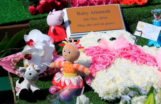 Soft toys, flowers and messages left on baby Alannah's grave. Photo: Gareth Chaney Collins