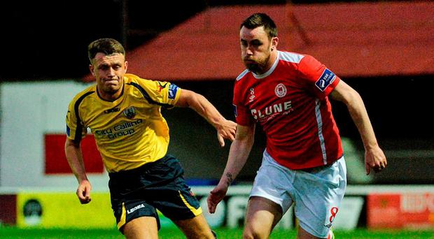 Keith Tracey of St Patrick's Athletic in action against Philip Gannon of Longford Town. Photo: Piaras O Midheach/Sportsfile