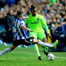 Brighton and Hove Albion's Gaetan Bong and Sheffield Wednesday's Andre Marco Matias battle for the ball. Photo: Martin Rickett/PA Wire.