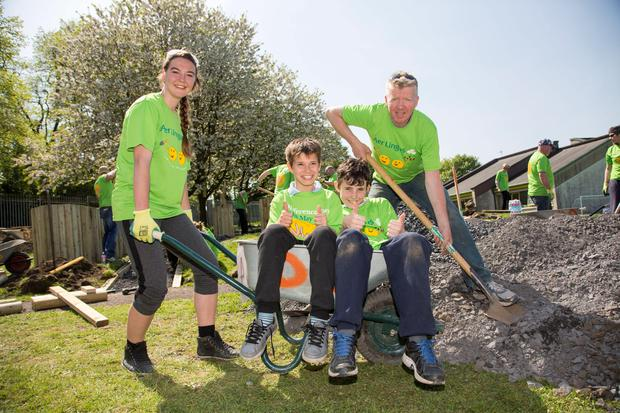 Aer Lingus staff members with pupils Madars Kuzis and Callum Smith who transformed a playground at St Mary's and St. Joseph's Merged, Primary School for Deaf Children, Cabra into a multi-zone space complete with a football pitch and an outdoor classroom. Pic:Mark Condren