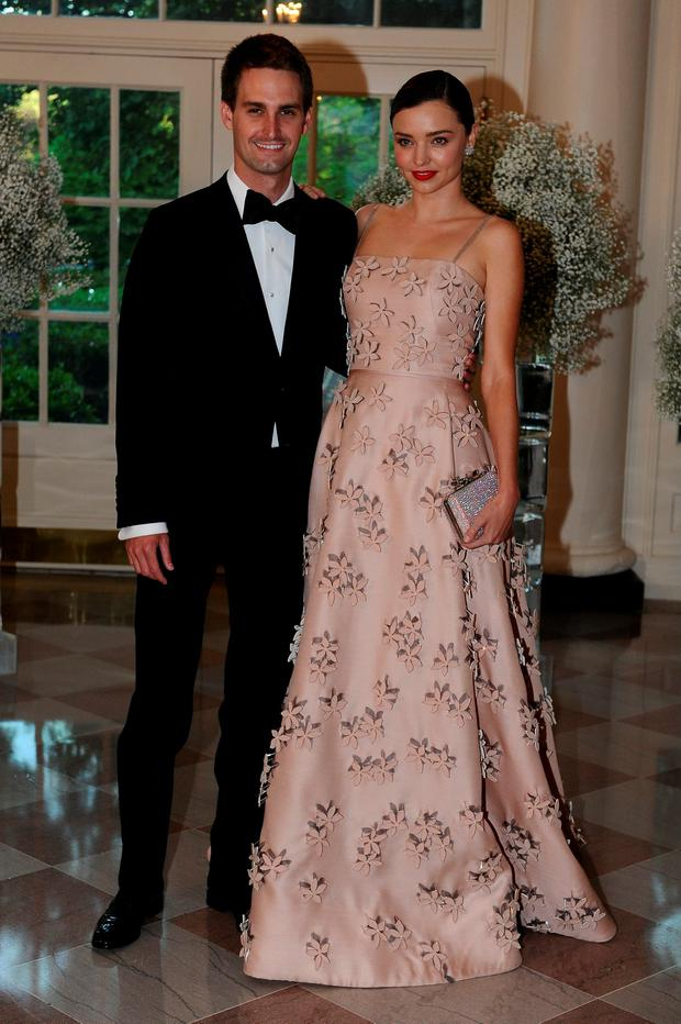Evan Spiegel, Chief Executive Officer, Snapchat and model Miranda Kerr arrive for the state dinner in honor of the Nordic Summit at the White House