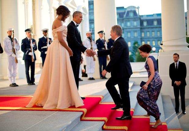 President Barack Obama and first lady Michelle Obama greet Finnish President Sauli Niinisto and his wife Jenni Haukio on the North Portico for a State Dinner at the White House