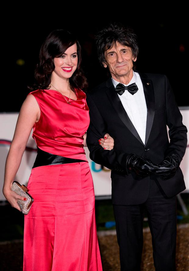 Ronnie Wood and Sally Wood attends The Sun Military Awards at National Maritime Museum on December 11, 2013 in London, England. (Photo by John Phillips/Getty Images)