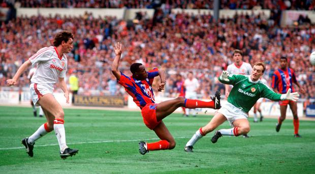Crystal Palace's Ian Wright scores past Manchester United's Jim Leighton in the 1990 FA Cup final. Photo: Bob Thomas/Getty Images