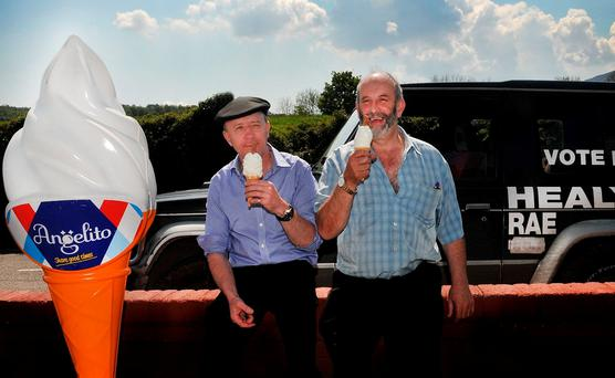 CHILLING: Michael and Danny Healy-Rae enjoying a five-minute break in the sunshine of Kilgarvan. Photo: Sally MacMonagle
