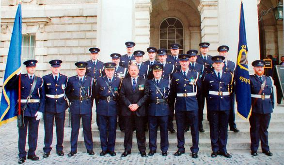 ANGER: In the original photograph of a Dublin ceremony the two officers, part of a guard of honour, are shown in the top right