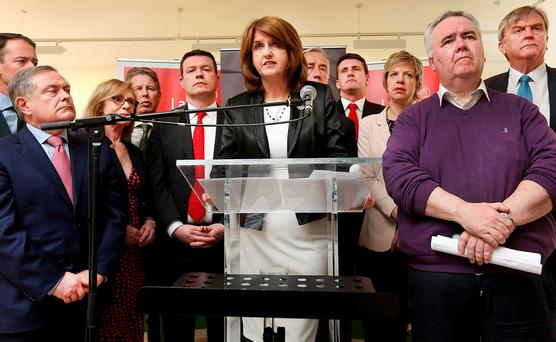 FAREWELL: Joan Burton announcing her resignation. Photo: Steve Humphreys