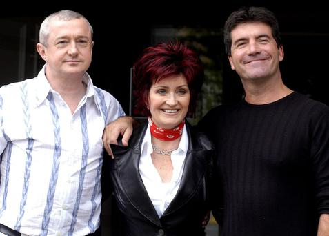 Louis Walsh, Sharon Osbourne and Simon Cowell pose for photos after auditioning hundreds of hopeful musicians for their new TV show