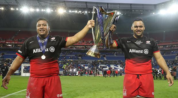 LYON, FRANCE - MAY 14: Mako Vunipola (L) and Billy Vunipola (R) of Saracens celebrate with the trophy after the European Rugby Champions Cup Final match between Racing 92 and Saracens at the Stade de Lyon on May 14, 2016 in Lyon, France. (Photo by David Rogers/Getty Images)