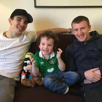 Little Rory Gallagher with boxers Michael Conlon and Paddy Barnes.