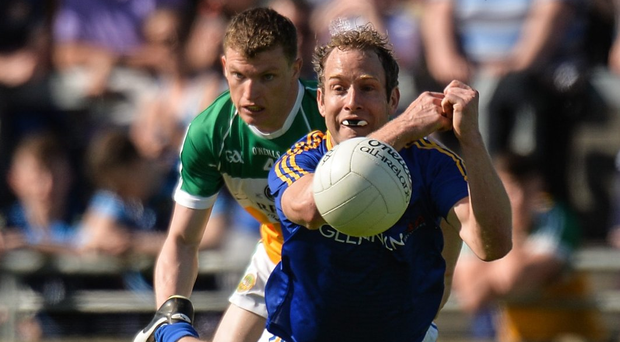 Longford's Brian Kavanagh under pressure from Seán Pender of Offaly during the Leinster SFC Round 1 game in Tullamore. Photo: Piaras O Midheach/Sportsfile