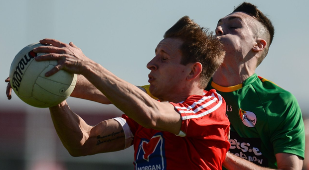 Louth's Anthony Williams battles with Carlow's Darren Lunney during the match. Photo: Piaras O Midheach/Sportsfile
