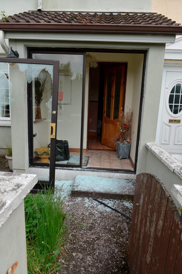 A smashed porch door window at the front of the house in the Hollywood Estate in Knocknaheeney, Cork. Photo: Michael Mac Sweeney