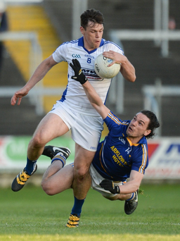 Laois's John O'Loughlin breaks free of a challenge by Wicklow's Paul Cunningham during the Leinster GAA Football Senior Championship, Round 1 match. Photo: Piaras O Midheach/Sportsfile