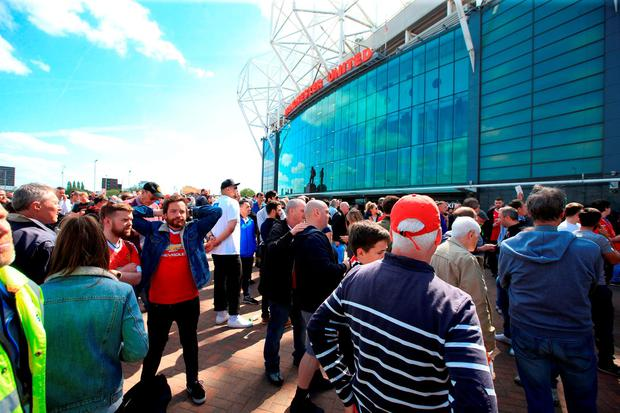 Supporters gather outside the stadium. Photo: PA