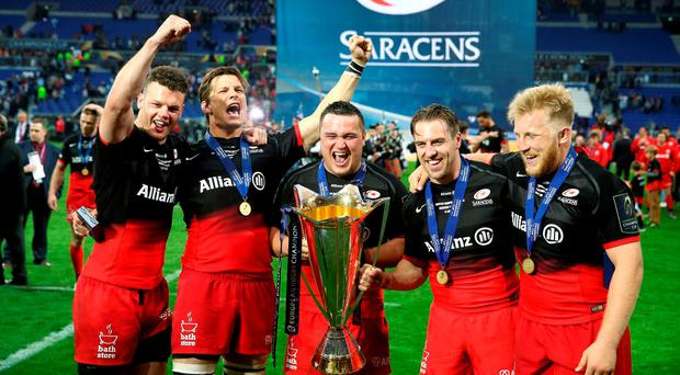 (left to right) Saracens' Duncan Taylor, Michael Rhodes, Jamie George, Chris Wyles and Jackson Wray celebrate winning the European Champions Cup. Photo: PA